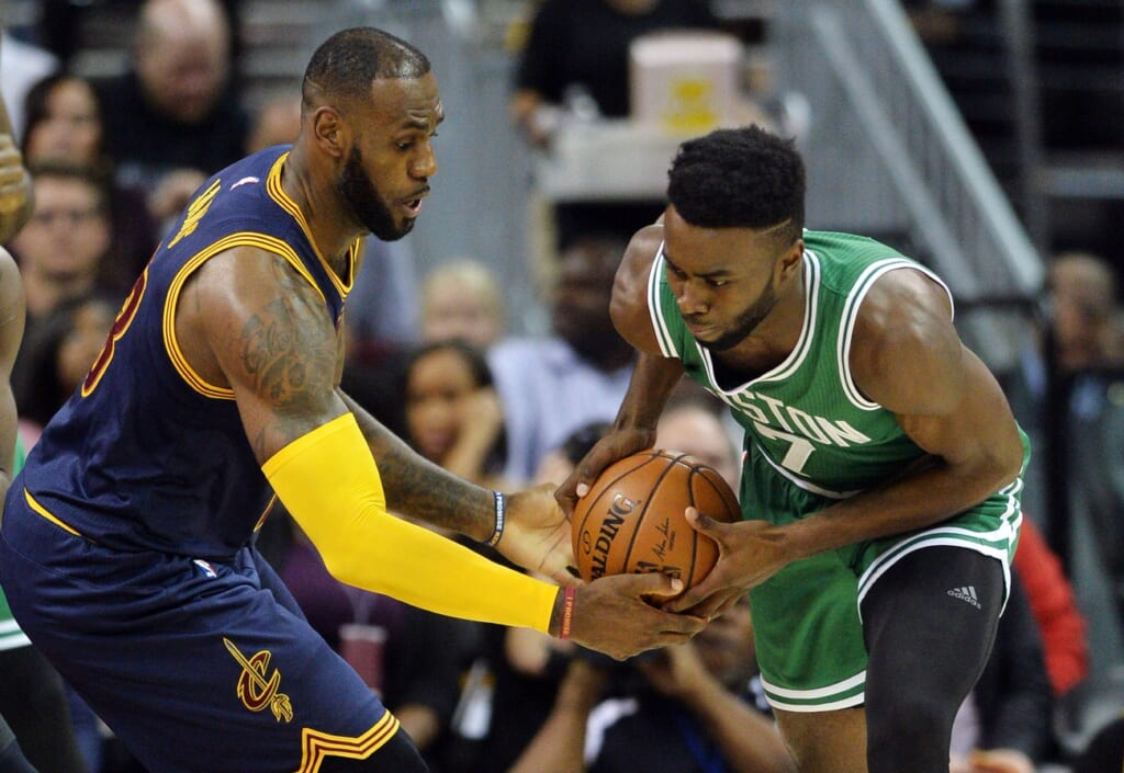 Caption: Nov 3, 2016; Cleveland, OH, USA; Cleveland Cavaliers forward LeBron James (23) fights for the ball with Boston Celtics forward Jaylen Brown (7) during the first quarter at Quicken Loans Arena. Mandatory Credit: Ken Blaze-USA TODAY Sports