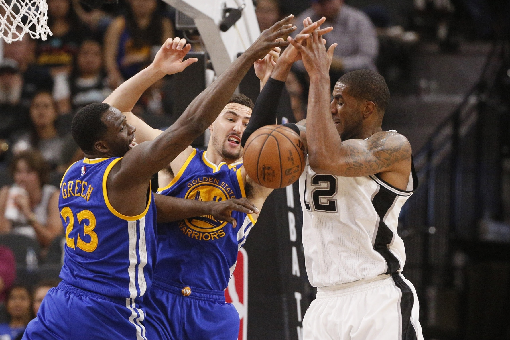 Mar 29, 2017; San Antonio, TX, USA; San Antonio Spurs power forward LaMarcus Aldridge (12) battle for a rebound with Golden State Warriors power forward Draymond Green (23) and Klay Thompson (11) during the second half at AT&T Center. Mandatory Credit: Soobum Im-USA TODAY Sports