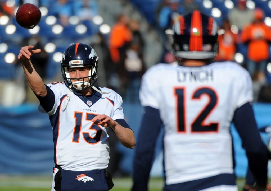 Paxton Lynch and Trevor Siemian warming up before a Broncos game