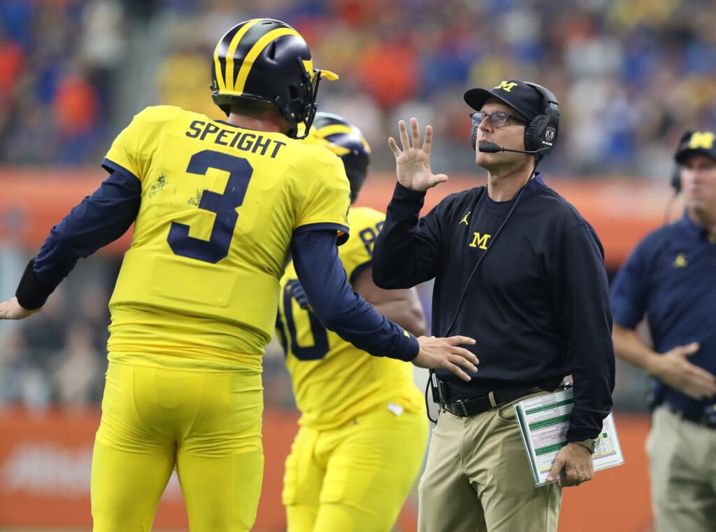 Michigan Quarterback Wilton Speight and head coach Jim Harbaugh