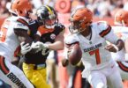 Cleveland Browns quarterback pursued by Pittsburgh Steelers linebacker T.J. Watt in NFL Week 1