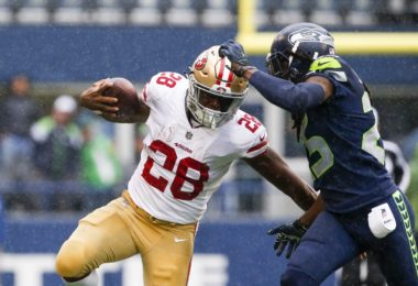 NFL San Francisco 49ers running back Carlos Hyde gets around Seattle Seahawks cornerback Richard Sherman