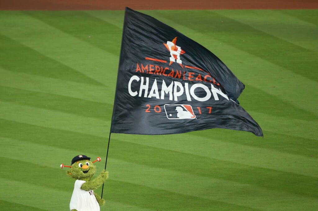 Houston Astros mascot Orbit waives flag after ALCS Game 7