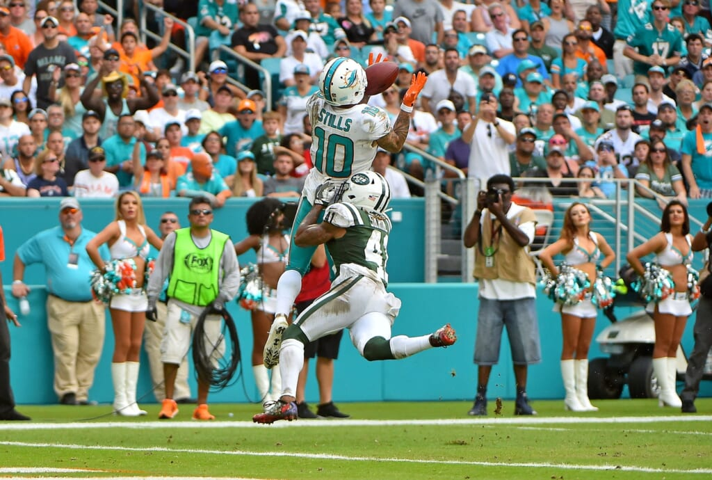 Miami Dolphins receiver Kenny StillsOct 22, 2017; Miami Gardens, FL, USA; Miami Dolphins wide receiver Kenny Stills (10) makes a catch over New York Jets cornerback Buster Skrine (41) for a touchdown during the second half at Hard Rock Stadium. Mandatory Credit: Jasen Vinlove-USA TODAY Sports