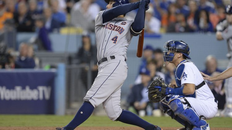 Houston Astros center fielder George Springer hits a solo home run against the Los Angeles Dodgers in the third inning in game six of the 2017 World Series at Dodger Stadium.