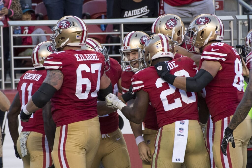 49ers players celebrate with C.J. Beathard in NFL Week 10