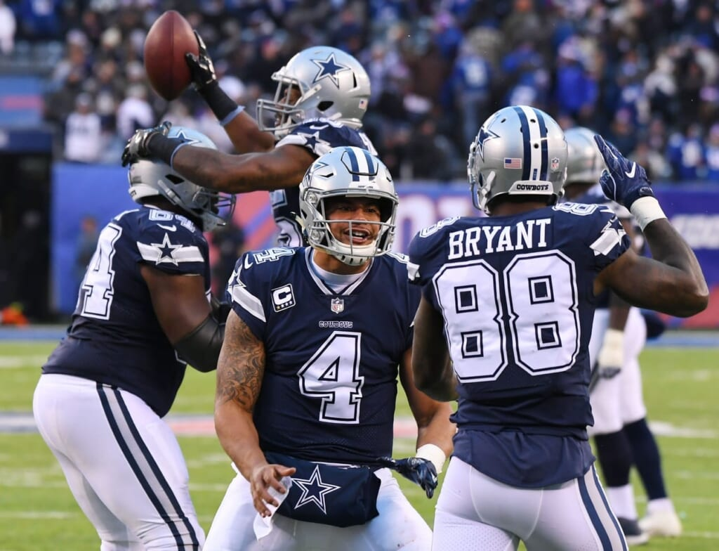 Cowboys celebrate with quarterback Dak Prescott