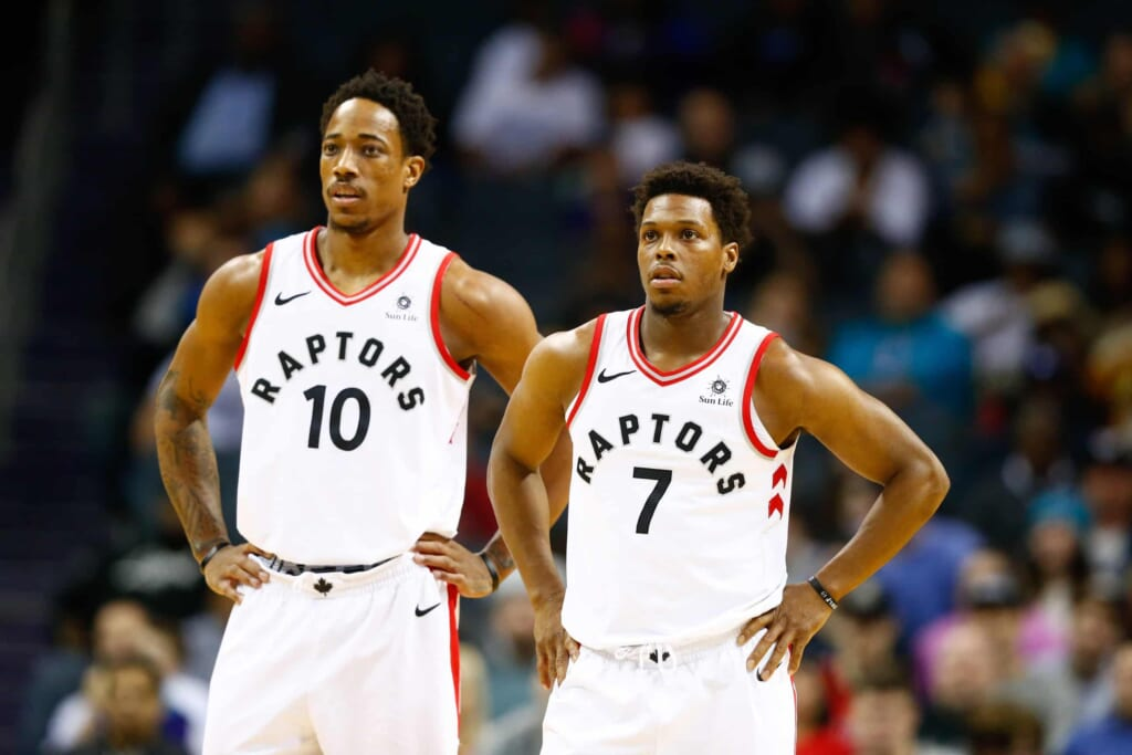 Feb 11, 2018; Charlotte, NC, USA; Toronto Raptors guard Kyle Lowry (7) and guard DeMar DeRozan (10) stands on the court in the first half against the Charlotte Hornets at Spectrum Center. Mandatory Credit: Jeremy Brevard-USA TODAY Sports