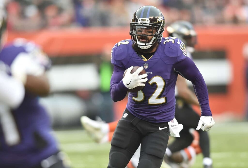 Ravens safety Eric Weddle intercepts a pass