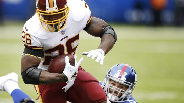 Adrian Peterson runs the ball against the New York Giants