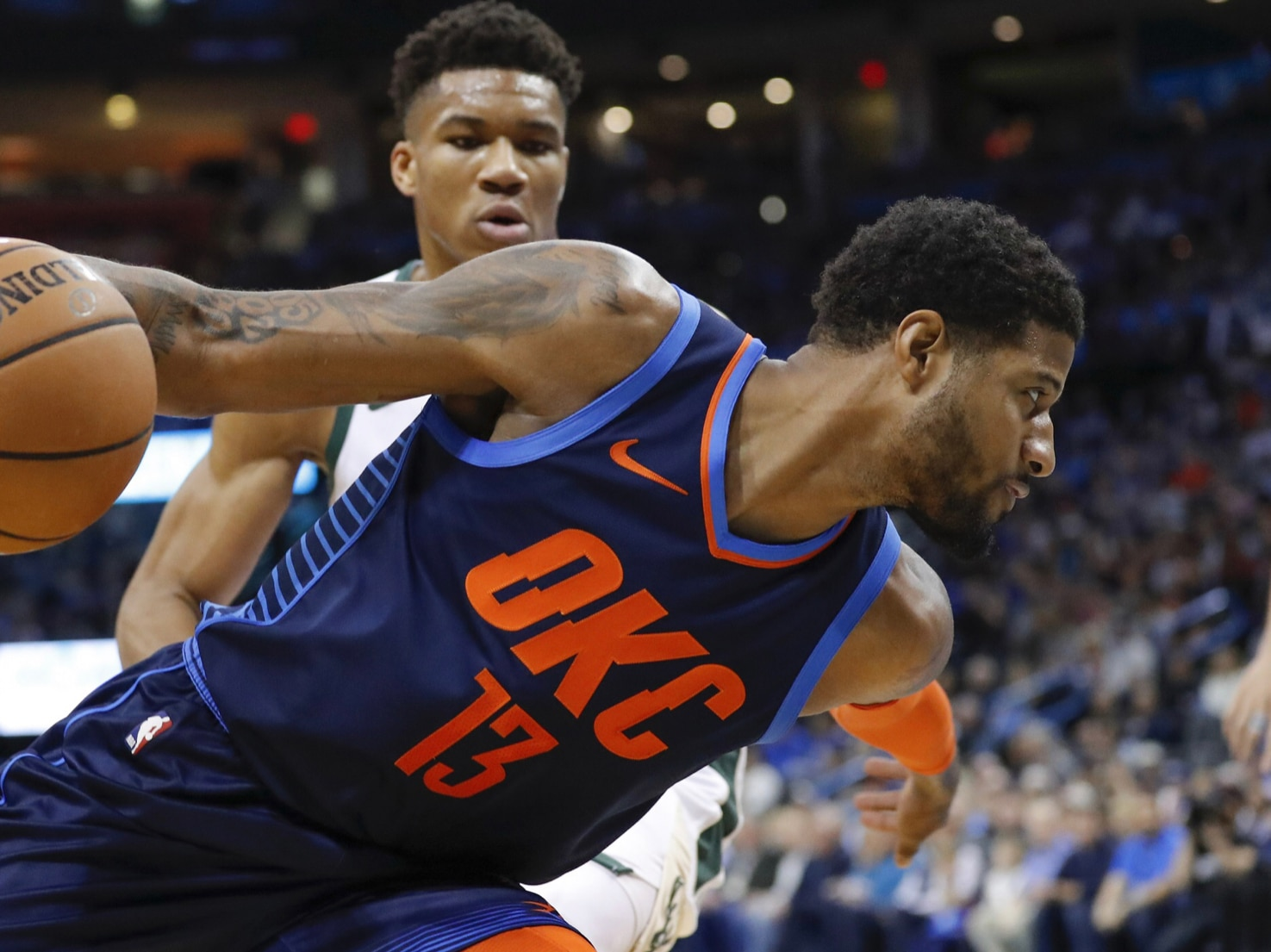 Thunder's Paul George places Greek Freak on a poster