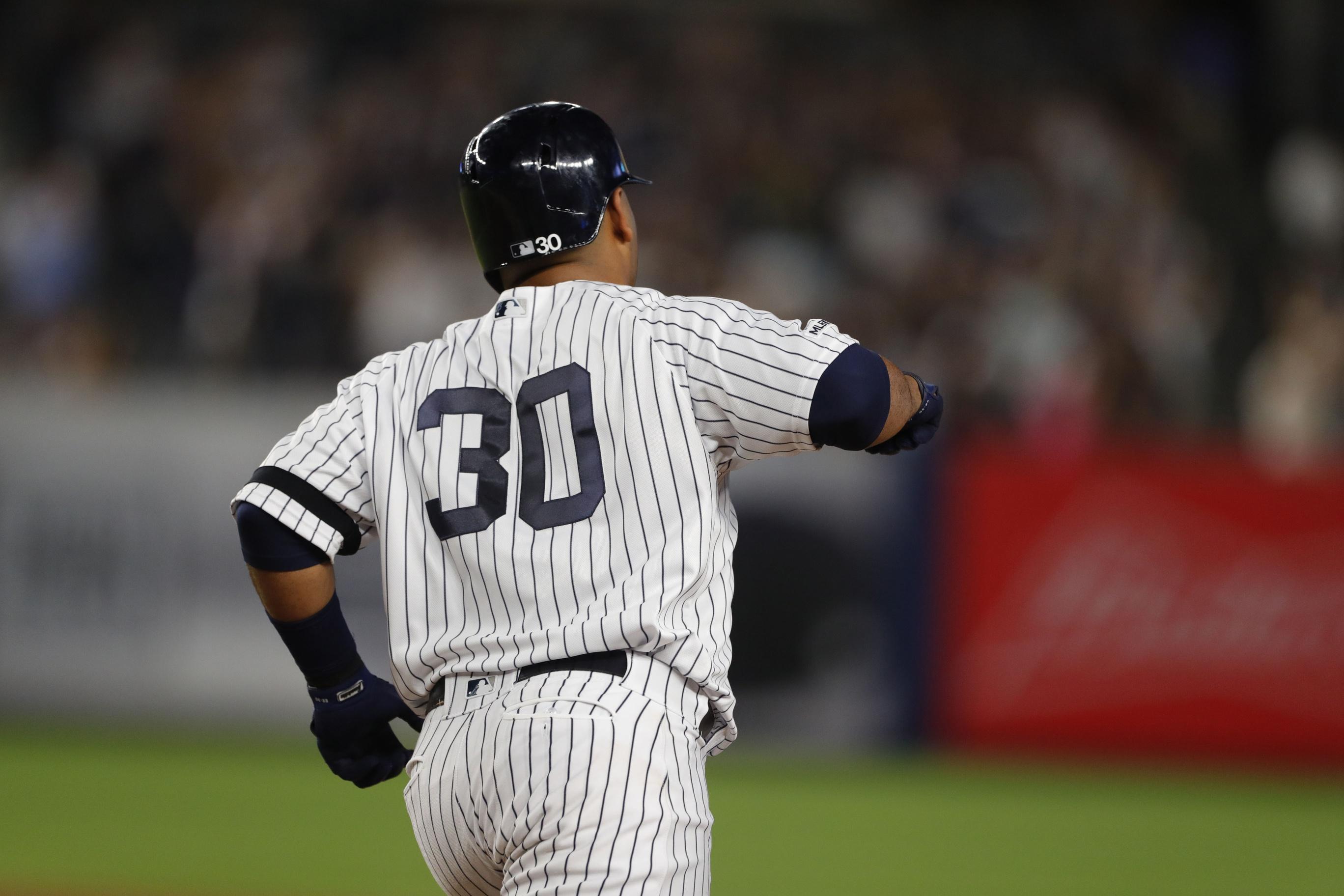 Scorching Yankees look for sweep of Rockies