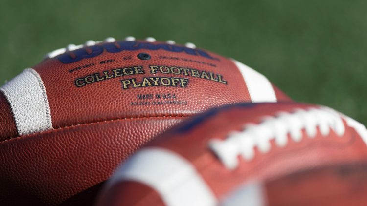 College footballs on field before game