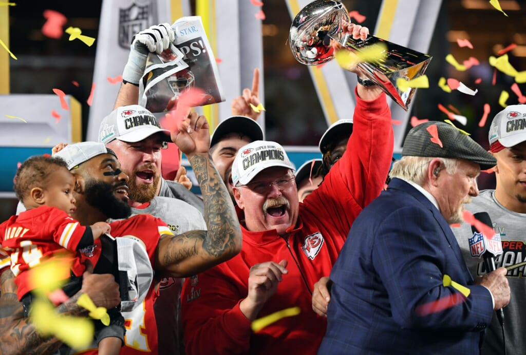 Feb 2, 2020; Miami Gardens, Florida, USA; Kansas City Chiefs head coach Andy Reid hoist the Vince Lombardi Trophy after defeating the San Francisco 49ers in Super Bowl LIV at Hard Rock Stadium. Mandatory Credit: Robert Deutsch-USA TODAY Sports