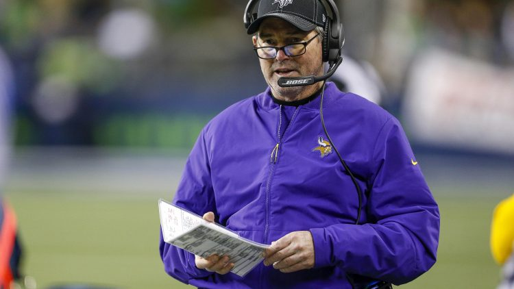 Mike Zimmer coaches on the sideline