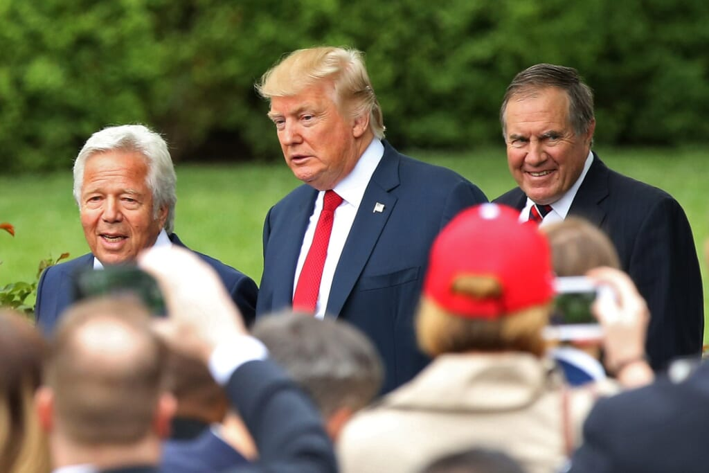President Donald Trump stands with NFL owner Robert Kraft and HC Bill Belichick