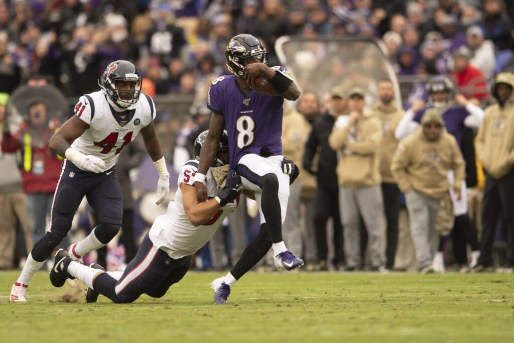 Lamar Jackson evades a tackle