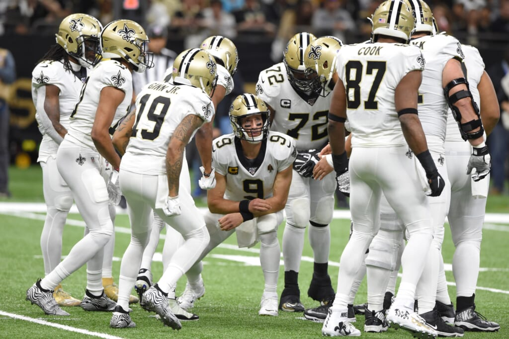 New Orleans Saints quarterback Drew Brees with his teammates