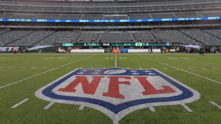 NFL logo at midfield during Jets football game