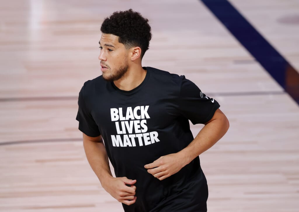 WATCH: Devin Booker sports Lakers shirt, pays homage to Kobe Bryant after win