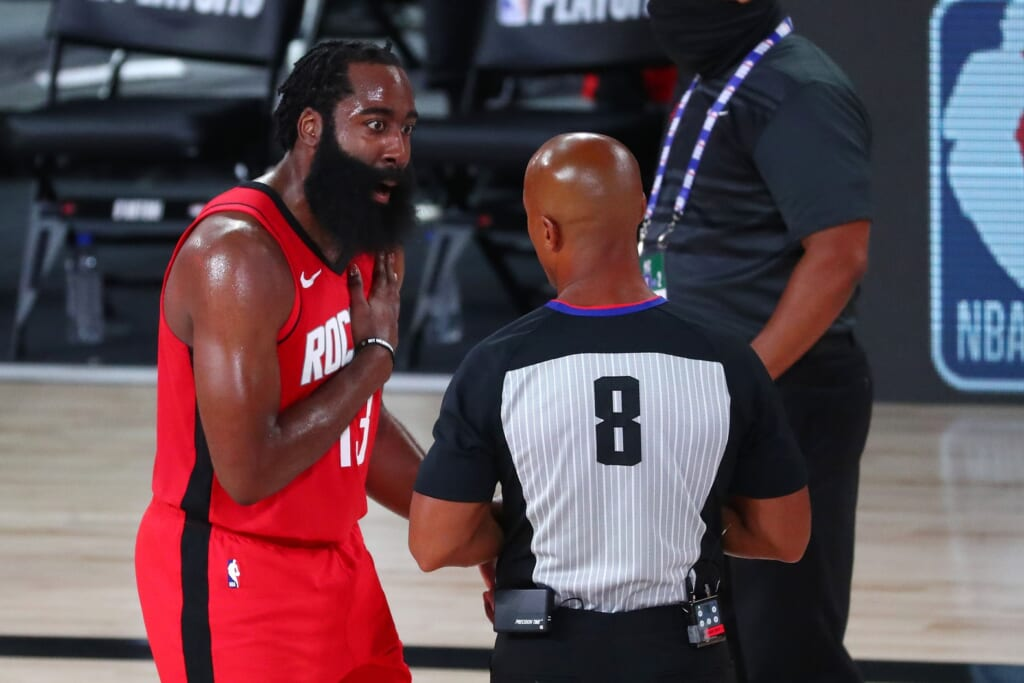 Rockets guard James Harden argues with official during NBA Playoff game against Thunder.
