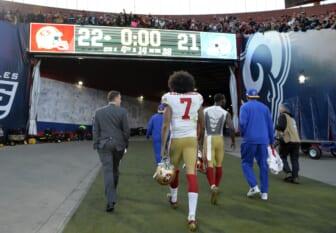 NFL quarterback Colin Kaepernick walks off the field