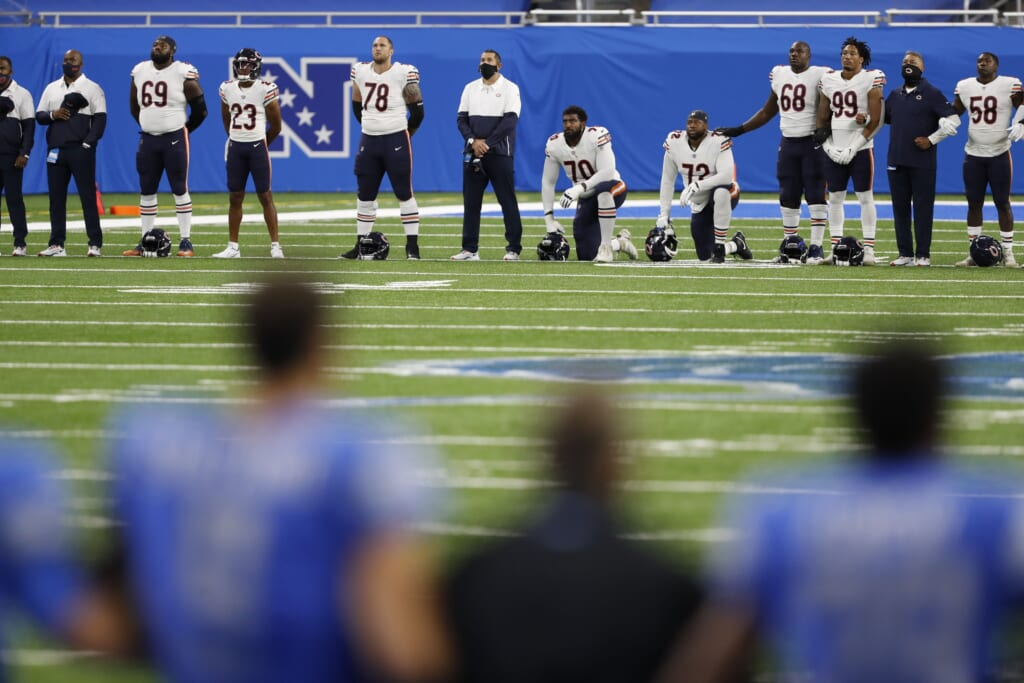 Chicago Bears and Detroit Lions players demonstrate in Week 1