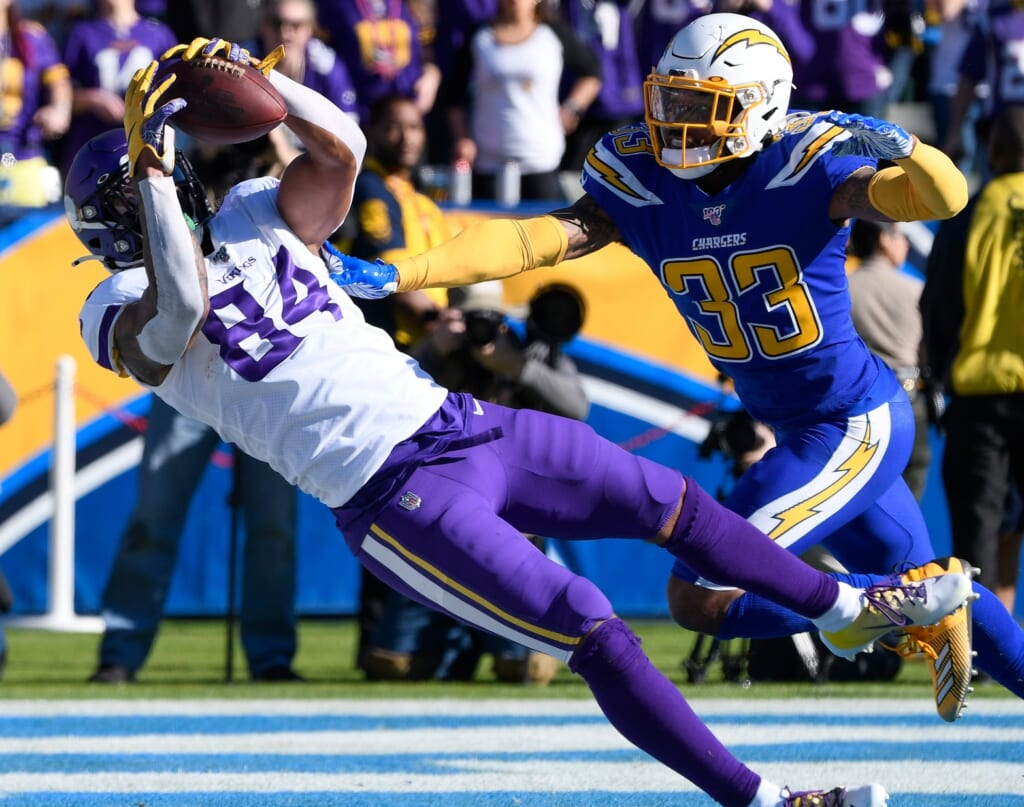 Dec 15, 2019; Carson, CA, USA; Minnesota Vikings tight end Irv Smith (84) makes a diving catch for a touchdown past Los Angeles Chargers free safety Derwin James (33) in the first quarter at Dignity Health Sports Park. Mandatory Credit: Robert Hanashiro-USA TODAY Sports