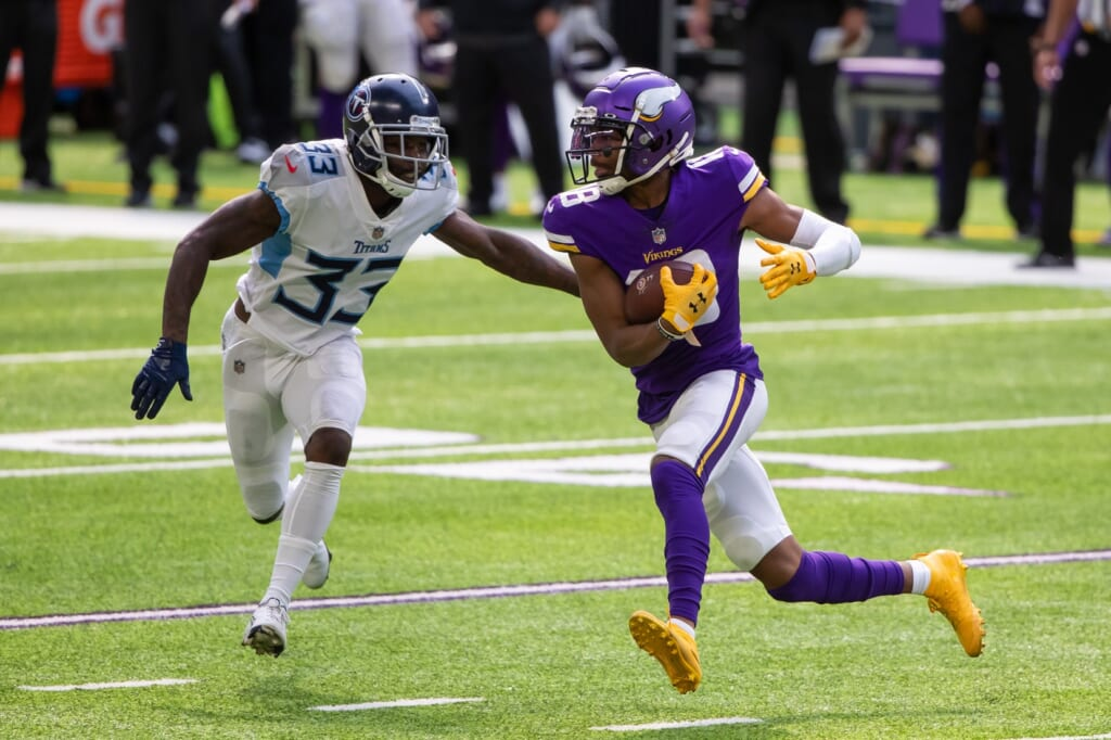 Sep 27, 2020; Minneapolis, Minnesota, USA; Minnesota Vikings wide receiver Justin Jefferson (18) runs after the catch in the second quarter against the Tennessee Titans defensive back Johnathan Joseph (33) at U.S. Bank Stadium. Mandatory Credit: Brad Rempel-USA TODAY Sports