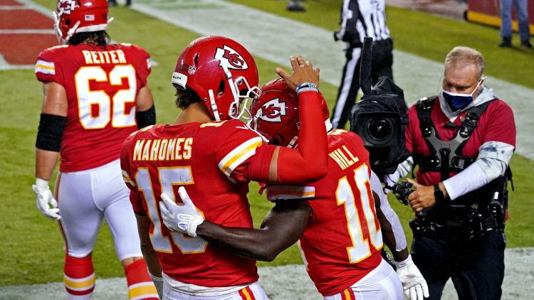Sep 10, 2020; Kansas City, Missouri, USA; Kansas City Chiefs wide receiver Tyreek Hill (10) celebrates with quarterback Patrick Mahomes (15) after scoring a touchdown during the second half against the Houston Texans at Arrowhead Stadium. Mandatory Credit: Denny Medley-USA TODAY Sports
