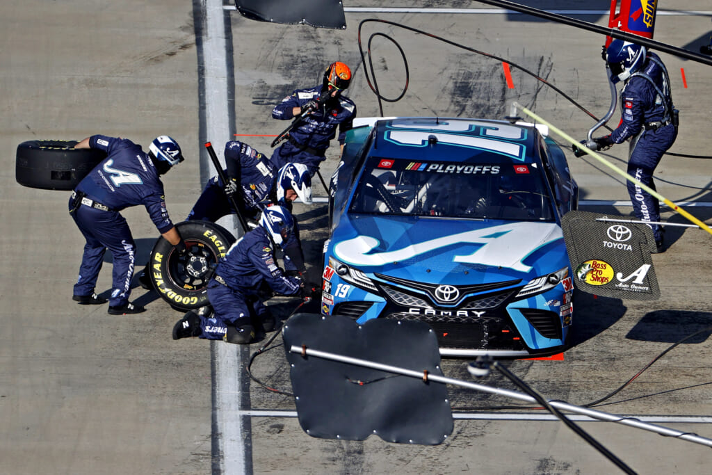 Nov 1, 2020; Martinsville, VA, USA; NASCAR Cup Series driver Martin Truex Jr. (19) makes a pit stop during the Xfinity 500 at Martinsville Speedway. Mandatory Credit: Peter Casey-USA TODAY Sports