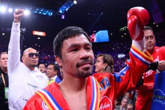 Jul 20, 2019; Las Vegas, NV, USA; Manny Pacquiao enters the ring to face Keith Thurman (not pictured) for their WBA welterweight championship bout at MGM Grand Garden Arena. Pacquiao won via split decision. Mandatory Credit: Joe Camporeale-USA TODAY Sports