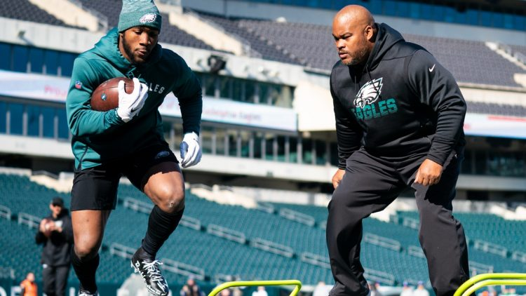Nov 3, 2019; Philadelphia, PA, USA; Philadelphia Eagles running back Miles Sanders (L) warms up in front of assistant coach Duce Staley (R) before a game against the Chicago Bears at Lincoln Financial Field. Mandatory Credit: Bill Streicher-USA TODAY Sports