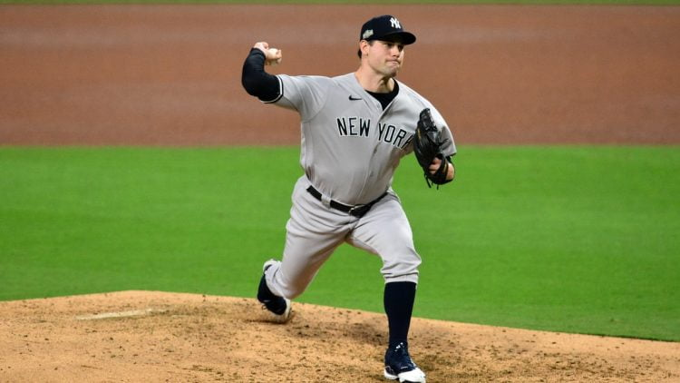 Oct 6, 2020; San Diego, California, USA; New York Yankees relief pitcher Adam Ottavino (0) delivers a pitch in the 4th inning against the Tampa Bay Rays during game two of the 2020 ALDS at Petco Park. Mandatory Credit: Gary A. Vasquez-USA TODAY Sports