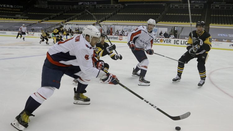 Jan 17, 2021; Pittsburgh, Pennsylvania, USA;  Washington Capitals left wing Alex Ovechkin (8) carries the puck against the Pittsburgh Penguins during the second period at the PPG Paints Arena. Mandatory Credit: Charles LeClaire-USA TODAY Sports