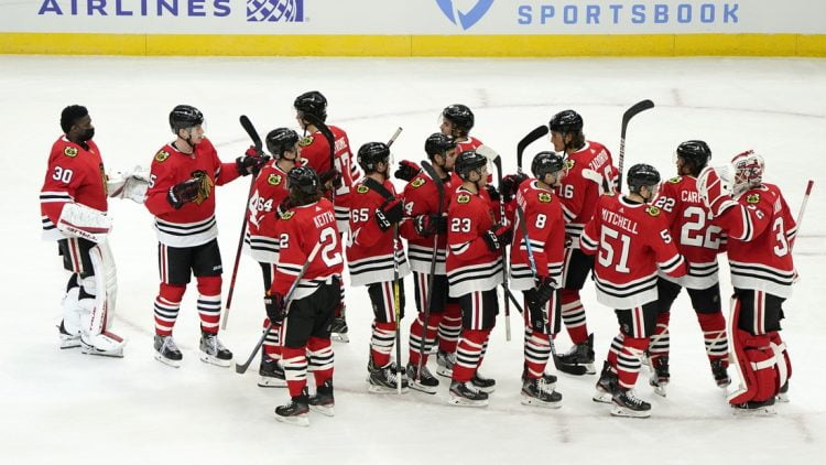 Jan 22, 2021; Chicago, Illinois, USA; The Chicago Blackhawks react after defeating the Detroit Red Wings at the United Center. Mandatory Credit: Mike Dinovo-USA TODAY Sports