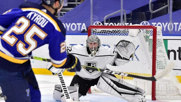 Jan 24, 2021; St. Louis, Missouri, USA;  Los Angeles Kings goaltender Jonathan Quick (32) defends the net against St. Louis Blues center Jordan Kyrou (25) during the first period at Enterprise Center. Mandatory Credit: Jeff Curry-USA TODAY Sports