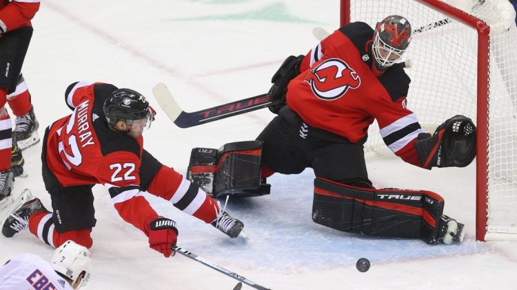 Jan 24, 2021; Newark, New Jersey, USA; New Jersey Devils goaltender Scott Wedgewood (41) defends his net during the third period of their game against the New York Islanders at Prudential Center. Mandatory Credit: Ed Mulholland-USA TODAY Sports