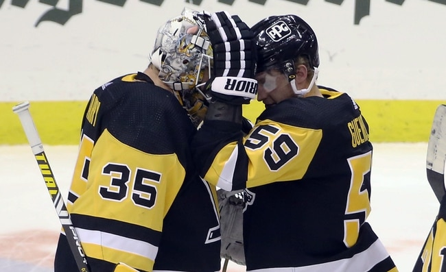 Jan 24, 2021; Pittsburgh, Pennsylvania, USA;  Pittsburgh Penguins goaltender Tristan Jarry (35) and left wing Jake Guentzel (59) celebrate after defeating the New York Rangers at the PPG Paints Arena. The Penguins won 3-2. Mandatory Credit: Charles LeClaire-USA TODAY Sports