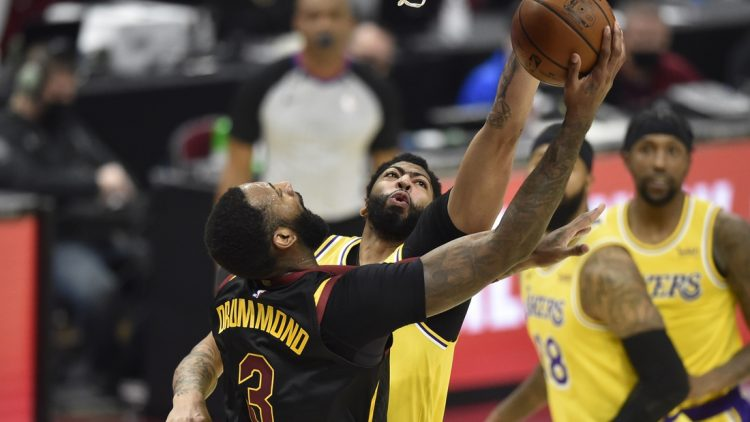 Jan 25, 2021; Cleveland, Ohio, USA; Los Angeles Lakers forward Anthony Davis (3) defends a shot by Cleveland Cavaliers center Andre Drummond (3) in the second quarter at Rocket Mortgage FieldHouse. Mandatory Credit: David Richard-USA TODAY Sports