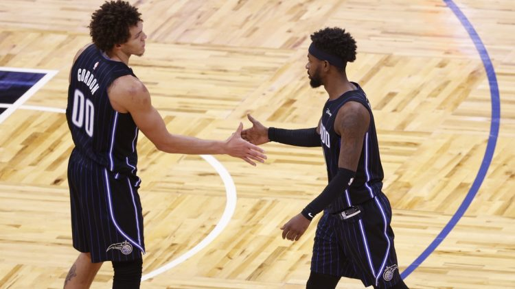 Jan 25, 2021; Orlando, Florida, USA; Orlando Magic guard Terrence Ross (31) and forward Aaron Gordon (00) high five each other as they beat the Charlotte Hornets at Amway Center. Mandatory Credit: Kim Klement-USA TODAY Sports