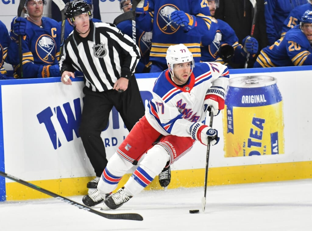 Jan 26, 2021; Buffalo, New York, USA; New York Rangers defenseman Tony DeAngelo (77) handles the puck in the third period against the Buffalo Sabres at KeyBank Center. Mandatory Credit: Mark Konezny-USA TODAY Sports