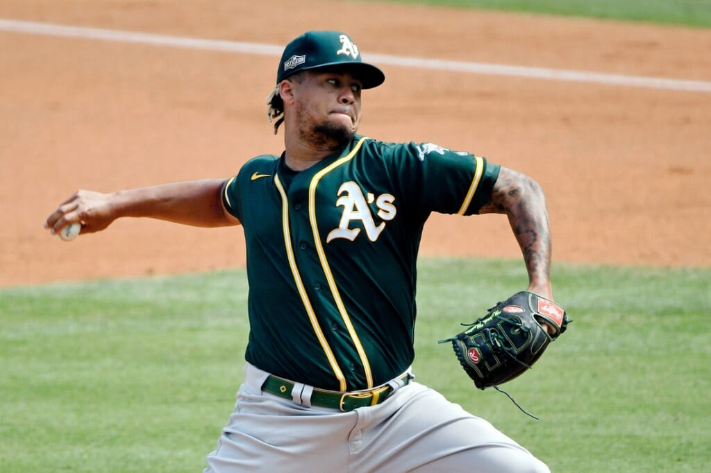 Oct 8, 2020; Los Angeles, California, USA; Oakland Athletics starting pitcher Frankie Montas (47) pitches against the Houston Astros during the first inning during game four of the 2020 ALDS at Dodger Stadium. Mandatory Credit: Robert Hanashiro-USA TODAY Sports