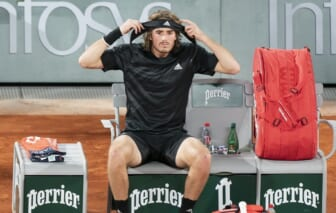 (File photo) Stefanos Tsitsipas (GRE) puts on a new headband at a change of ends during his match against Novak Djokovic (SRB) on day 13 at Stade Roland Garros. Mandatory Credit: Susan Mullane-USA TODAY Sports