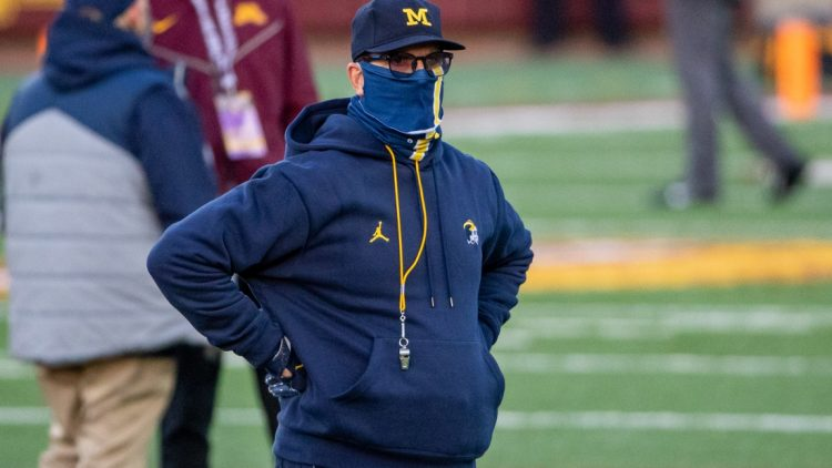Oct 24, 2020; Minneapolis, Minnesota, USA; Michigan Wolverines head coach Jim Harbaugh looks on during pre game warmups before a game against the Minnesota Golden Gophers at TCF Bank Stadium. Mandatory Credit: Jesse Johnson-USA TODAY Sports