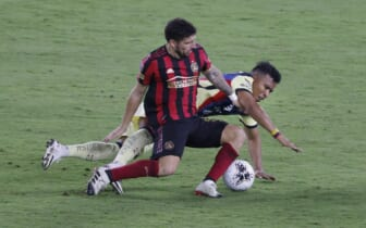 Dec 16, 2020; Orlando, Florida, USA; Atlanta United midfielder Eric Remedi (left) and Club America forward Roger Martinez (right) battle for the ball in the second half during the 2020SCCL quarterfinals at Exploria Stadium. Mandatory Credit: Reinhold Matay-USA TODAY Sports