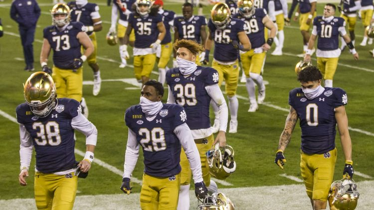 Dec. 19, 2020; Charlotte, NC, USA; Notre Dame players head to the locker room following the ACC Championship football game on Saturday, Dec. 19, 2020, inside Bank of America Stadium in Charlotte, NC. Clemson won 34-10. Mandatory Credit: Robert Franklin/South Bend Tribune via USA TODAY NETWORK