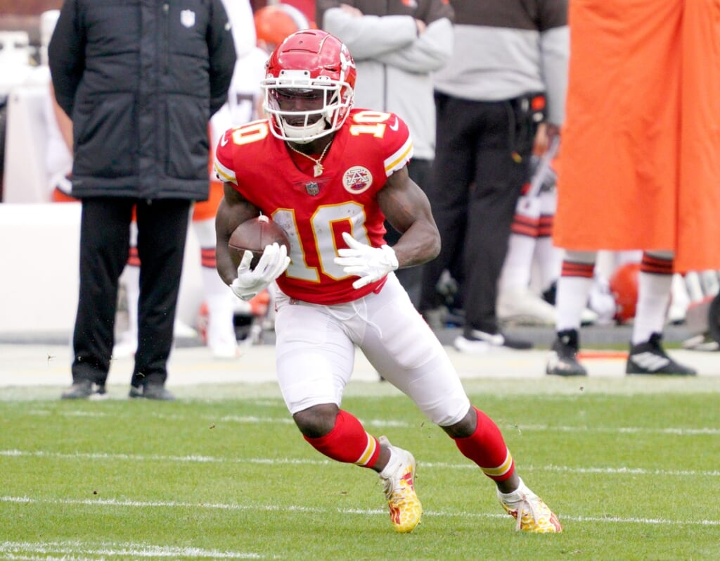 Jan 17, 2021; Kansas City, Missouri, USA; Kansas City Chiefs wide receiver Tyreek Hill (10) runs the ball during the AFC Divisional Round playoff game against the Cleveland Browns at Arrowhead Stadium. Mandatory Credit: Denny Medley-USA TODAY Sports