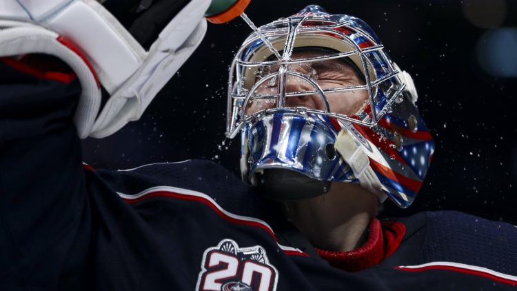 Jan 23, 2021; Columbus, Ohio, USA; Columbus Blue Jackets goaltender Elvis Merzlikins (90) sprays water onto his face prior to the start of the third period against the Tampa Bay Lightning at Nationwide Arena. Mandatory Credit: Aaron Doster-USA TODAY Sports