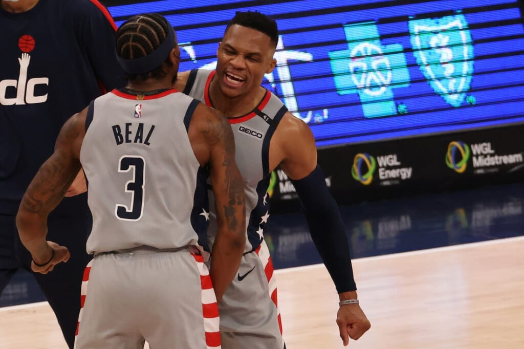 Jan 31, 2021; Washington, District of Columbia, USA; Washington Wizards guard Russell Westbrook (4) celebrates with Wizards guard Bradley Beal (3) after making the go ahead three point field goal against the Brooklyn Nets in the final seconds in the fourth quarter at Capital One Arena. Mandatory Credit: Geoff Burke-USA TODAY Sports